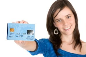 bigstock_Casual_Girl_Holding_A_Credit_C_1122974